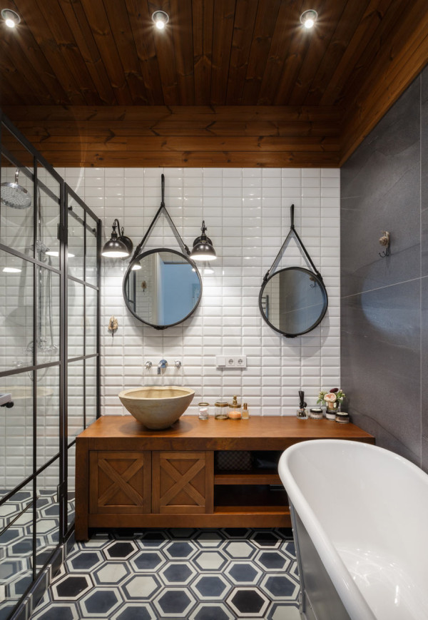 The first bathroom is decorated with an industrial feel