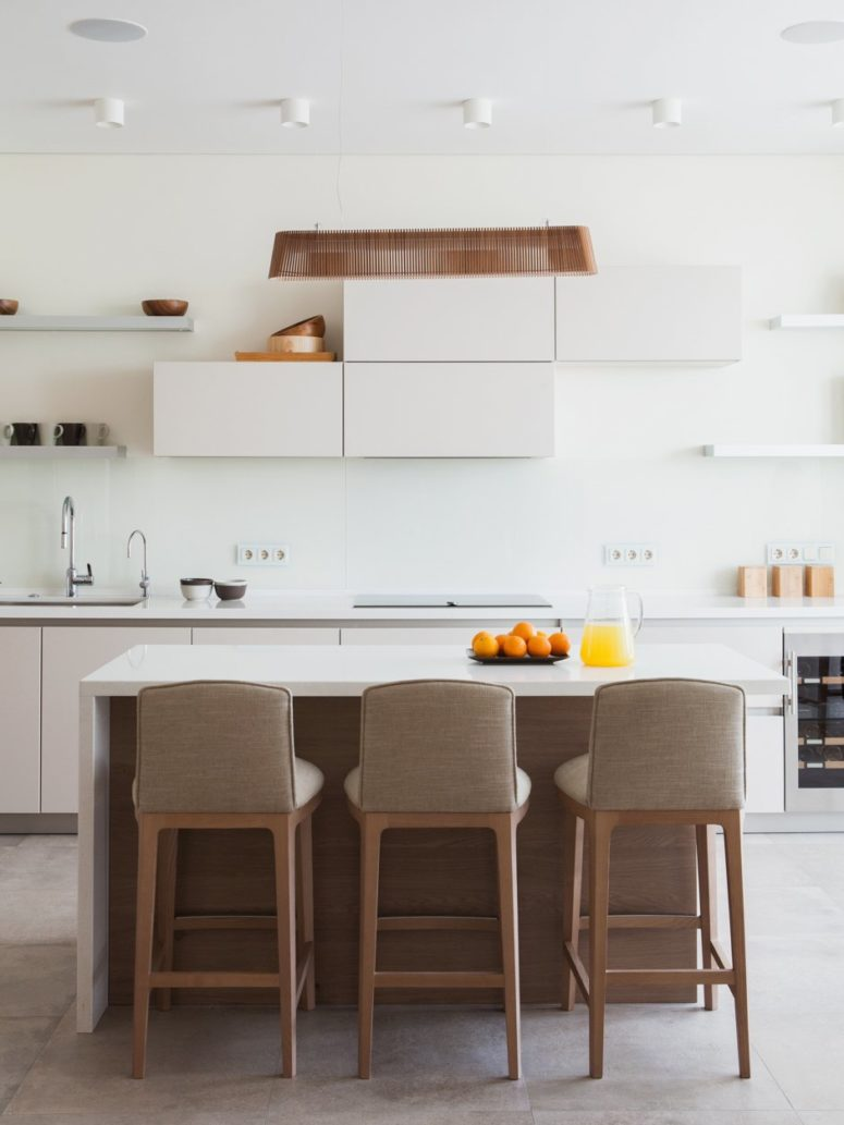 The kitchen is minimalist white, the surfaces are clean and sleek, just like in Japan