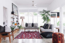 08 The lounge space is decorated with a bold rug and lots of island potted greenery