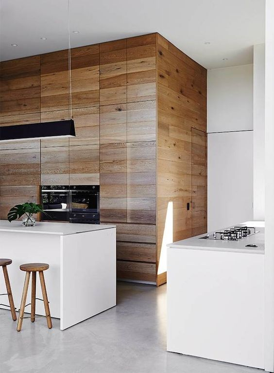 almost white concrete continues modern decor theme in this kitchen