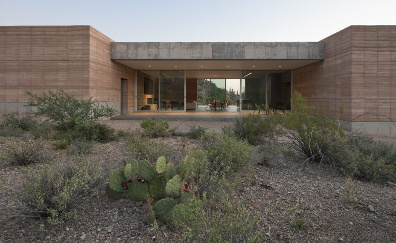 The architects describe their design as being 'rooted in the desert', due to its pared down natural aesthetic that blends seamlessly with its setting