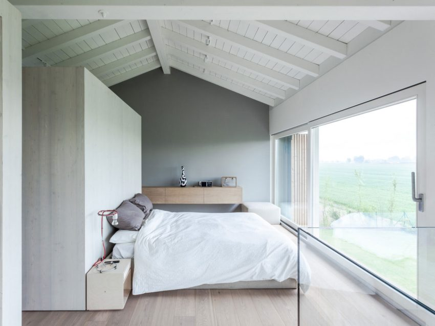 The master bedroom is decorated around the views of nature outside, such a light and dreamy space