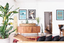 09 The use of natural wood furniture and accessories and bold wall art makes the home trendier