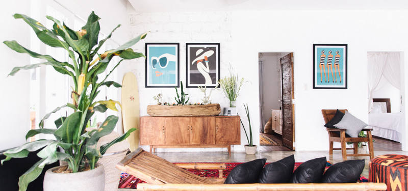The use of natural wood furniture and accessories and bold wall art makes the home trendier