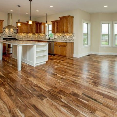 acacia hardwood plank floors in several tones