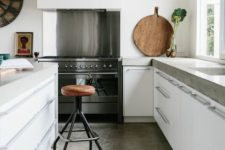 09 sleek concrete with a natural look makes the kitchen more stylish