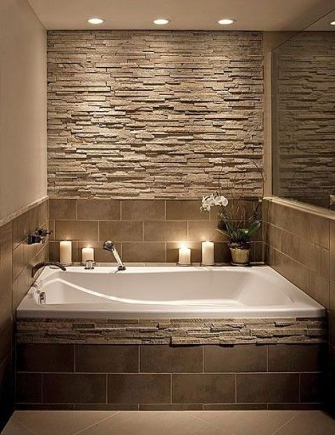 Stone Accent Wall And Bathtub Decor In Earthy Colors