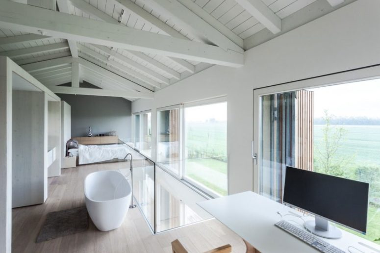 The free-standing bathtub and a home office nook can boast of wonderful views