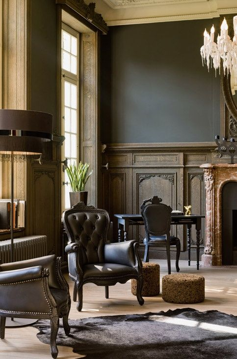 antique dark panels add to the refined look of the room