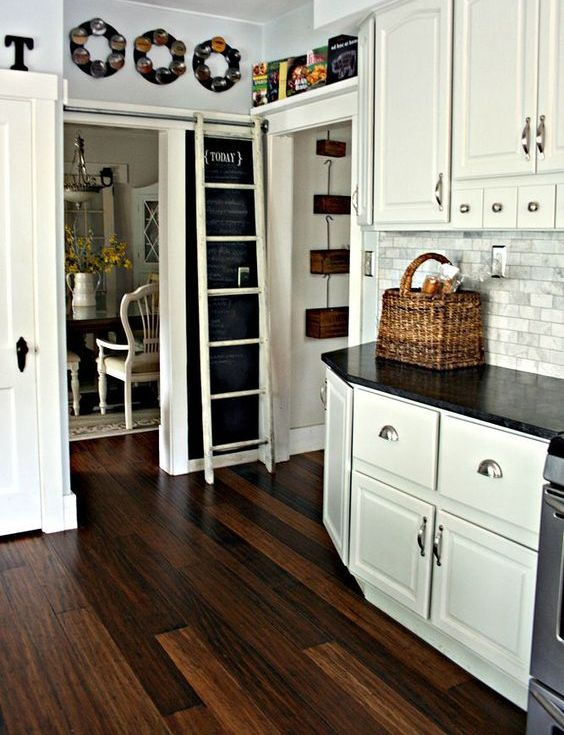 contrasting dark grain floors is a perfect kitchen flooring choice when cabinets are painted are white