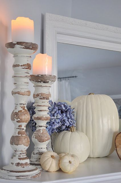 cream fall mantel with pumpkins and candles in shabby chic candle holders