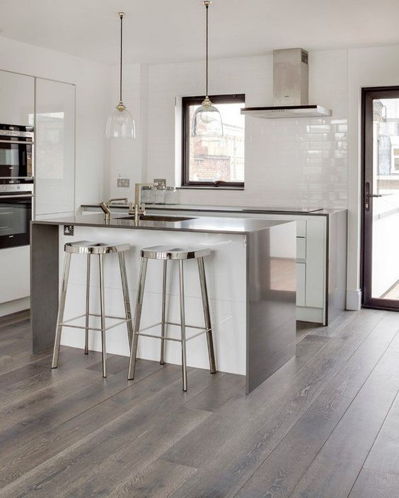 grey hardwood floors look awesome with stainless steel kitchen items