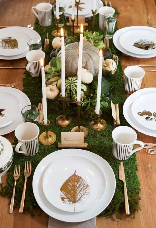 moss table runner, pumpkins, gilded candle holders and leaves
