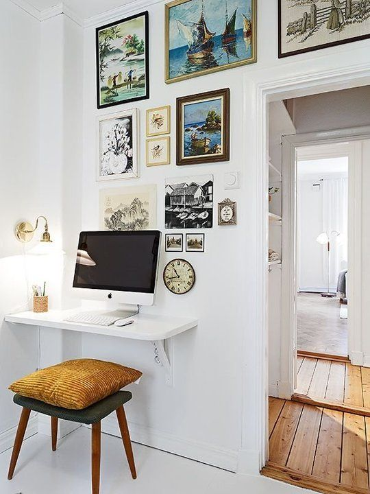 tiny corner used as an office nook with a wall-mounted desk