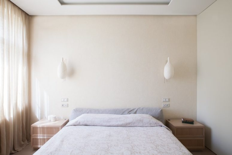 The master bedroom is airy and serene, the decor is simple and really reminds of Japan