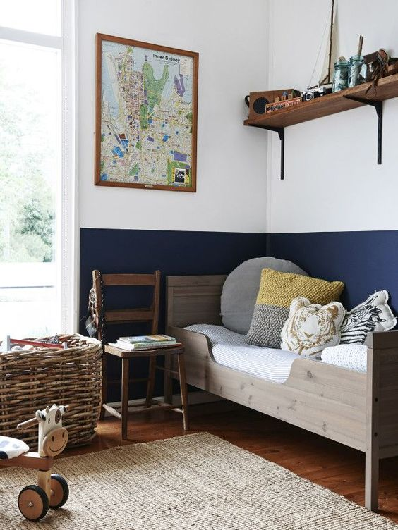 comfy wooden bed and open shelving with favorite toys above it