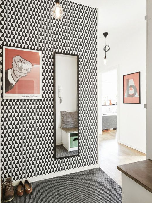 monochrome geometric wallpaper in the entryway for an eye catching touch