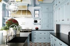 11 red, blue and cream floor tile creates an ambience in this kitchen