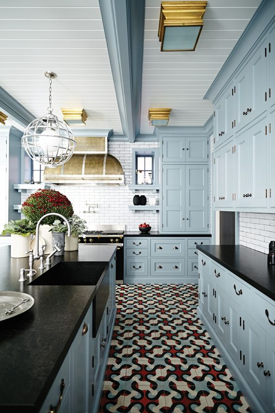 Red, Blue And Cream Floor Tile Creates An Ambience In This Kitchen