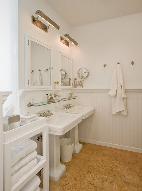 Traditional White Bathroom Is Highlighted With Warm Cork Floors