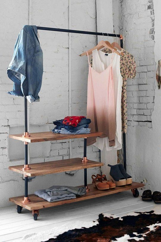 wood and blackened steel rack with several shelves & 26 Clothes Racks For Homes With No Closet Space - DigsDigs