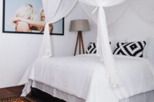 12 Another bedroom is smaller but the airy canopy makes the bed very inviting