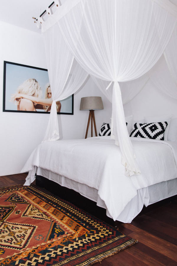 Another bedroom is smaller but the airy canopy makes the bed very inviting