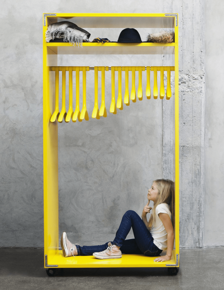 bold yellow designer's rack made of MDF with 3D printed hangers