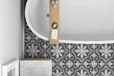 12 grey and white porcelain tiles create an eye-catchy touch in this bathroom