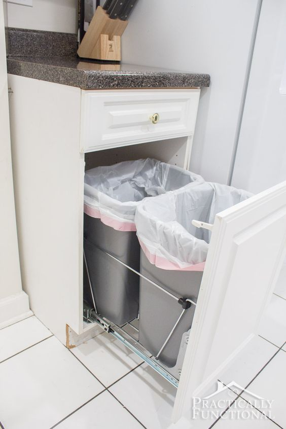 pull-out trash cans hidden in one of the ktichen cabinets