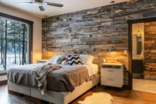 12 reclaimed wood wall paneling makes the room comfier