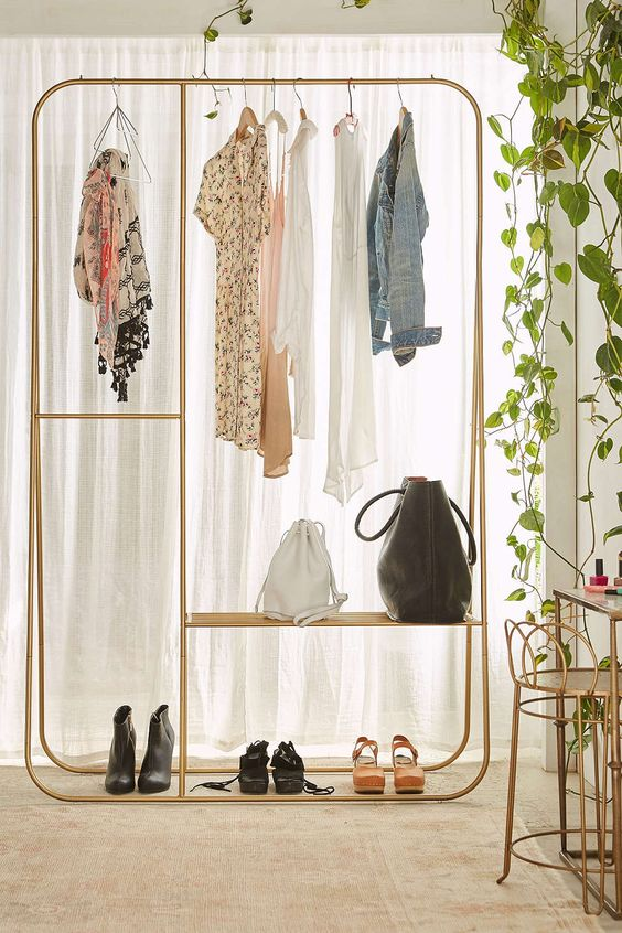 double clothing rack with a bag shelf
