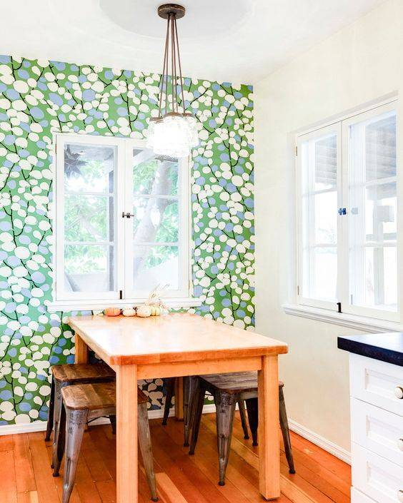 fun-printed wallpaper sets up a mood in this breakfast nook