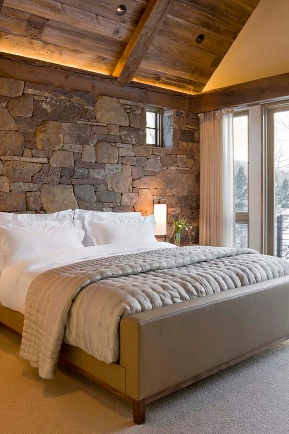 natural stone accent wall behind the headboard makes this bedroom cozier and more inviting - Accent Walls For Bedrooms