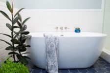 14 blue hexagon tiles and greenery make up the whole bathroom decor