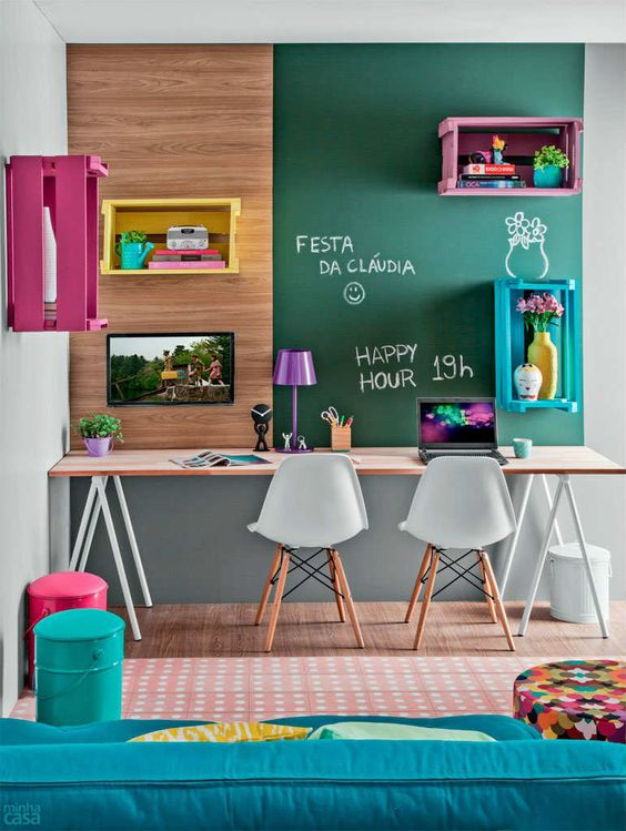 colorful study space with a chalkboard wall and open shelving
