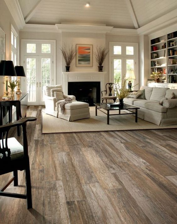 Putting A Rug On The Hardwood Floors Will Make Them Less Loud And Warmer