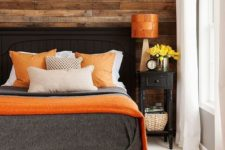 14 warm wood and orange accents make this bedroom inviting and positive