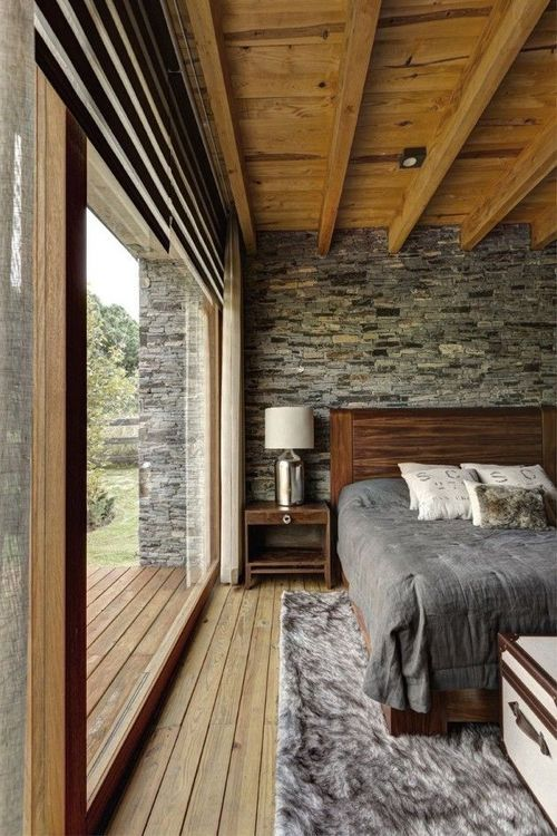 dark grey headboard wall contrasts with warm woods