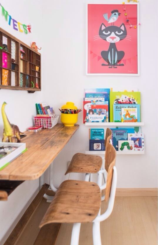 homework station with bookshelves and a wall storage unit