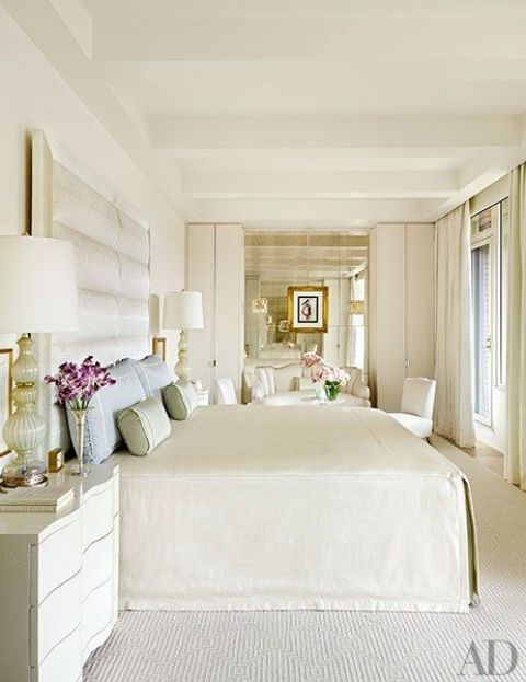 cream-colored floors continue the decor theme and add coziness to the space