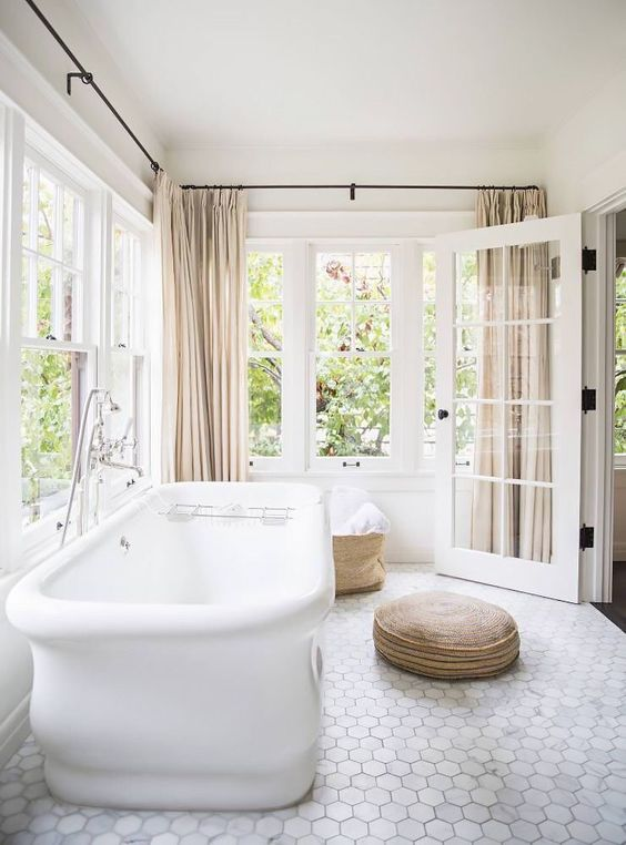 marble hex tile floors make this bathroom more refined