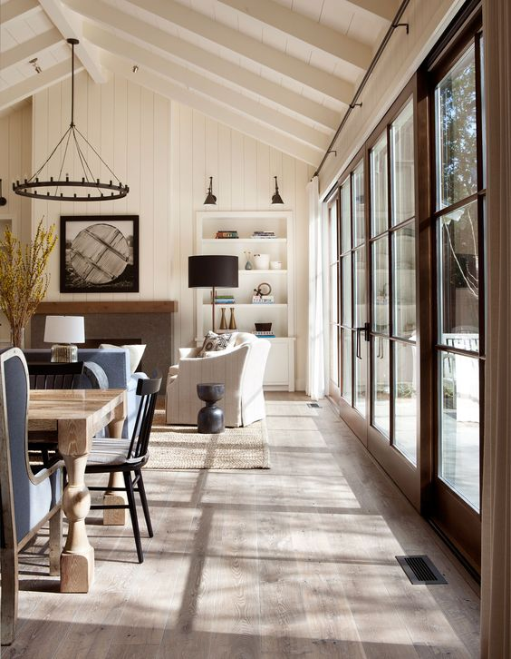 custom-stained oak hardwood flooring and white-washed exposed beams create a rustic ambiance