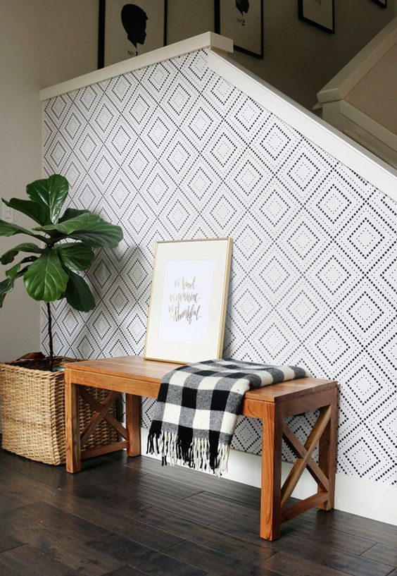 dotted geometric wallpaper to highlight the staircase wall