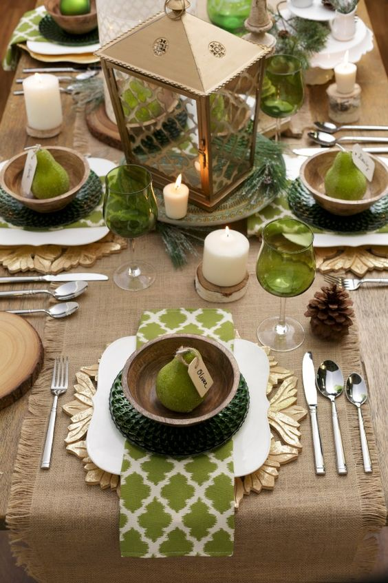 green glass, sage green napkins and dark green chargers with burlap accents