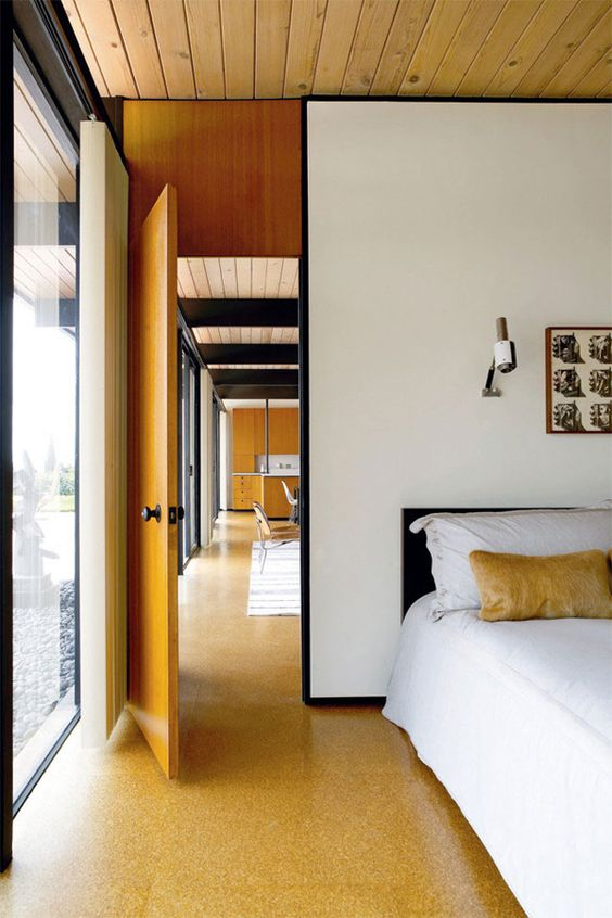 cork floors highlight the mid-century modern decor of this bedroom