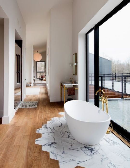 marble-printed tiles only under the bathtub to prevent wooden floors from water damage