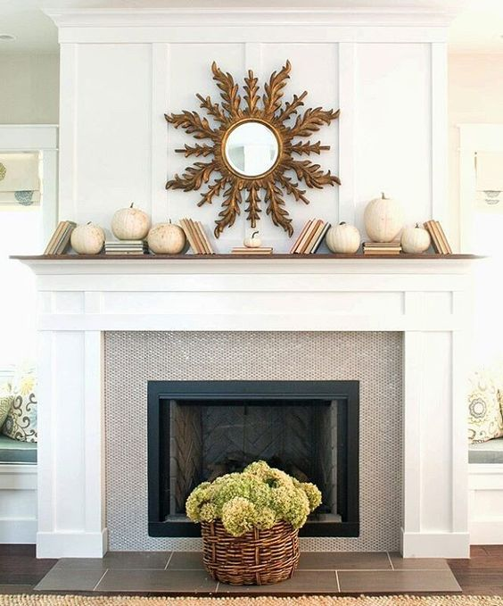 simple decor with white pumpkins and a sunburst mirror
