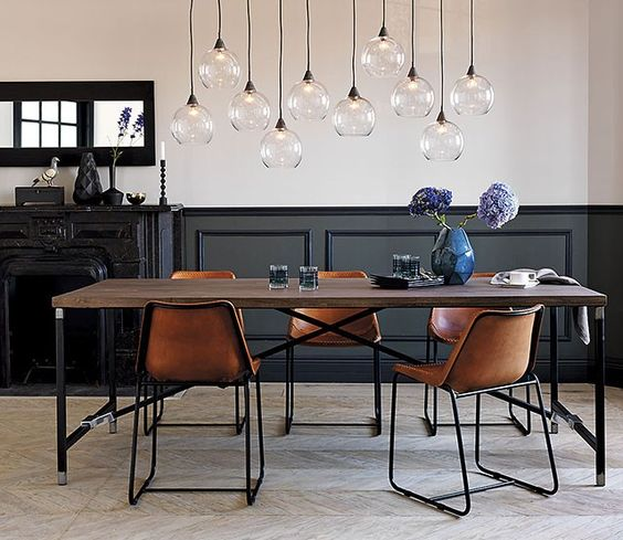 Black Wainscoting In An Industrial Dining Space