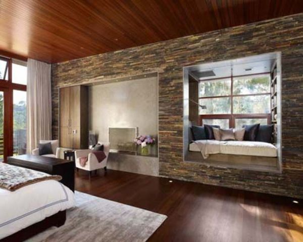 brilliant use of hardwood and stone for a modern cabin bedroom